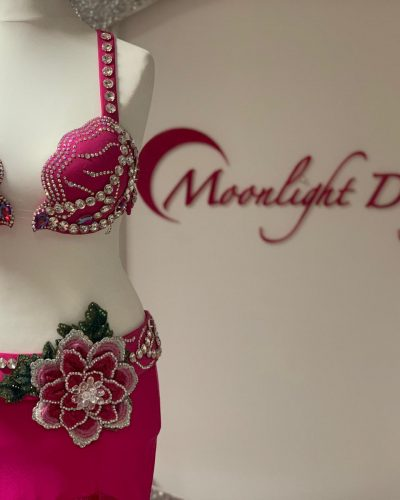 Fuxia belly dance costume with flowers is a Moonlight Design's creation