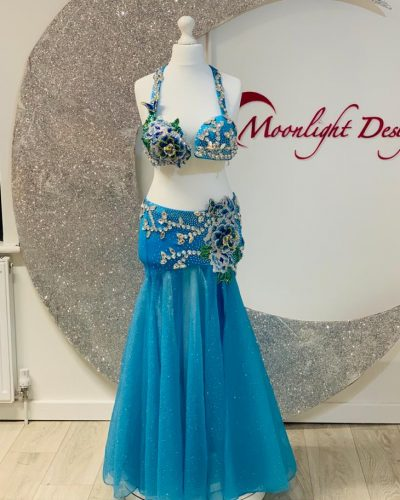 Turquoise costumes is made with flowers and butterflies. Creation by Moonlight design